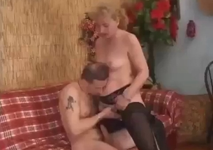 Mom in stockings is riding her son hard dick