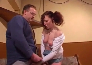 Pigtailed sister blows her brother on the knees