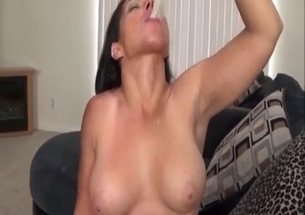 Busty brunette swallows tasty cumshot of her bro
